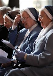 Nuns pray at the remains of Saint Therese of Lisieux in Westminster Cathedral at the end of their nationwide tour on October 13, 2009 in London, England.