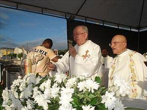 Luiz Marques Barbosa, center, has been removed from his post, his bishop says.