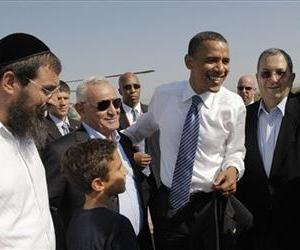 Then-candidate Barack Obama greets well-wishers as he arrives in Sderot, Israel, Wednesday, July 23, 2008.