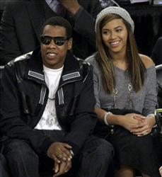 Jay-Z, left, and Beyonce watch the NBA All-Star basketball game Sunday, Feb. 15, 2009, in Phoenix.