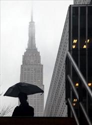 Fog mutes the top of the Empire State Building.