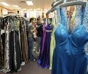 Girls shop for prom dresses in this file photo.