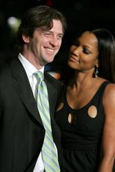 Garcelle Beauvais (R) and husband Mike Nilon arrive at the Warner Bros. premiere of 'We Are Marshall' held at the Grauman's Chinese Theatre on December 14, 2006 in Hollywood, California.