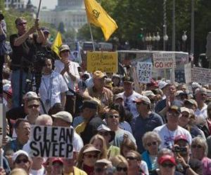 In this April 15, 2010 file photo, the Capitol is seen in the background, as Tea Party demonstrators gather at Freedom Plaza in Washington.