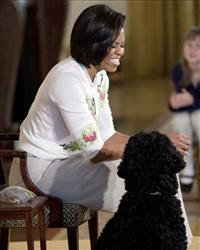 First lady Michelle Obama laughs during an event to welcome children of Executive Office employees at the White House's annual take our daughters and sons to work day, April  22, 2010 in Washington.