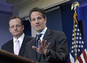 Treasury Secretary Timothy Geithner, right, accompanied by White House Press Secretary Robert Gibbs, gestures during the daily briefing at the White House in Washington, Wednesday, April  14, 2010.
