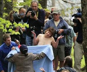 Counterprotester Elaine Graham tries to get University of Maine at Farmington student Andrea Simoneau to cover up during a topless march April 30, 2010, in Farmington, Maine.