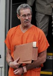 Allen Stanford steps off a prison transport bus.