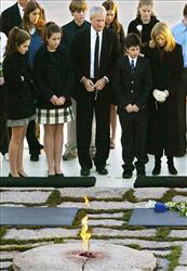 In this Nov. 22, 2003 file photo, Caroline Kennedy is joined by her family at the grave of her father John F. Kennedy at Arlington National Cemetery on the 40th anniversary of his death.