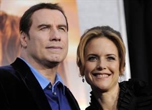 In this March 25, 2010 file photo, Kelly Preston, right, a cast member in The Last Song, arrives with her husband John Travolta at the premiere of the film in Los Angeles.