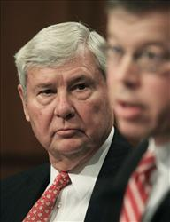 In this Dec. 11, 2008 file photo, former Florida Sen. Bob Graham, left, listens during testimony on Capitol Hill.