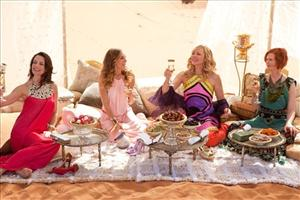 In this film publicity image released by Warner Bros., from left, Kristin Davis, Sarah Jessica Parker, Kim Cattrall and Cynthia Nixon are shown in a scene from Sex and the City 2.