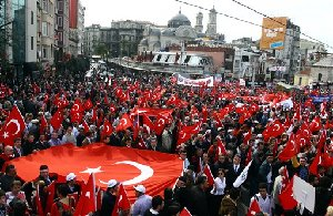 Turkish people wave national flags during a protest against the separatist Kurdish rebel group, the PKK, or Kurdistan Workers Party, in downtown Istanbul, Turkey, Tuesday, Oct. 23, 2007. Turkish Prime Minister Recep Tayyip Erdogan said that his nation cannot wait forever for the Iraqi government to act against rebels in...