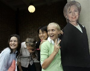 Wellesley College students, from left, Sara Brandt-Vorel, Amy Bisno, Min Yi, and Lauren Nelson mug with a life-size cardboard photo of Democratic Presidential hopeful Sen. Hillary Rodham Clinton, D-N.Y. before entering Wellesley College's Alumnae Hall in Wellesley, Mass. Thursday, Nov. 1, 2007, to listen to Clinton's campaign speech. (AP...