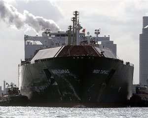 The liquefied natural gas tanker Inigo Tapias makes its way through Boston Harbor past downtown Boston in this Jan. 24, 2004 file photo. While the energy industry regards liquid natural gas as a vital step in keeping up with US demand for natural gas, proposals to build terminals are raising...