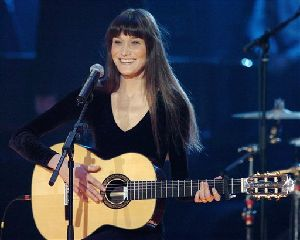 Italian former top model and singer Carla Bruni performs at the Victoires de la Musique 2004 awards ceremony at the Zenith, in Paris in this Feb. 28, 2004 file photo. Recently divorced French President Nicolas Sarkozy doesn't appear to be hiding his latest love interest. He visited Disneyland Paris with...