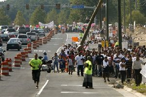 People march in protest along Prince William Parkway in Woodbridge, Va., Sunday, Sept. 2, 2007. The march and rally, organized by the immigrant rights group Mexicans Without Borders, was held in protest of measures passed this July by Prince William County to deny a potentially wide range of public services...