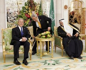 President Bush is greeted by Saudi King Abdullah at the King's Palace in Riyadh, Saudi Arabia, Monday, Jan. 14, 2008. In the center is US interpreter Gamal Helal.  (AP Photo/Susan Walsh)