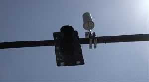 In this still frame taken from video, a MetroFi's transmitter affixed to a street sign is shown, Friday, June 1, 2007, in Portland, Ore. Wi-Fi hotspots are growing in number around the country but security experts warn that they can be favorite hangouts for hackers. (AP Photo/Rick Bowmer)