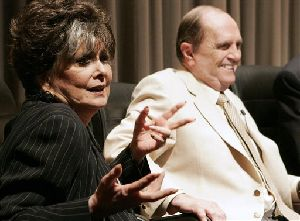 In a photo provided by TV Land,  actress Suzanne Pleshette speaks during a panel discussion as actor Bob Newhart  looks on at the TV Land 35th anniversary celebration of the Bob Newhart Show in Beverly Hills, Calif. on Wednesday, Sept. 5, 2007. (AP Photo/Dan Steinberg, TV Land)