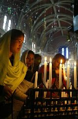 Pakistani women light candle during a Christian memorial service for assassinated opposition leader Benazir Bhutto Sunday Jan. 6, 2008 in Lahore, Pakistan. Bhutto's widowed husband implicated members of Pakistan's ruling regime in his wife's killing and called for a U.N. investigation, as British officers aiding Pakistan's own probe pored...