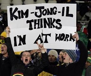 Fans hold up a banner referring to North Korean leader Kim Jong Il prior to the World Cup group G soccer match between Brazil and North Korea at Ellis Park Stadium in Johannesburg.