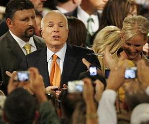 John McCain looks towards supporters pointing cell phone cameras while signing autographs after a rally at Lehigh University in Bethlehem, Pa, Oct. 8, 2008.