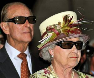 Prince Philip and Queen Elizabeth wear 3D glasses to watch a film at the Pinewood Studios in Toronto, Monday, July 5, 2010.