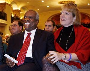 Virginia Lamp Thomas, right,sits with Clarence Thomas before his speech at the Federalist Society in Washington, in this Nov. 15, 2007 file photo.