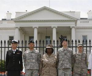 Service members who have been dismissed because of Don't Ask, Don't Tell are seen handcuffed to the fence outside the White House during a protest against the policy, April, 2010.