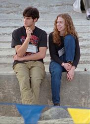 In this Dec. 1996 file photo, Chelsea Clinton, right, sits with Marc Mezvinsky on the beach at Hilton Head Island, S.C.