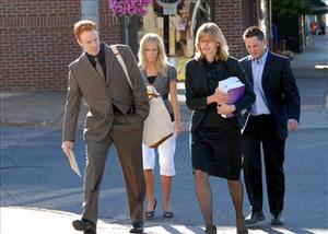 Defense attorney intern Ted Greeley, left, and lead attorney Sarah Henderson, second from right, walk with clients Allison Coss and Scott Sippola to the courthouse in Marquette, Mich. July 13, 2010.