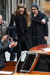 Actors Angelina Jolie and Brad Pitt are helped into a boat in Venice, Italy, Tuesday, Feb. 16, 2010.