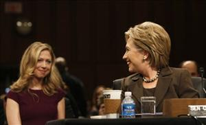 Chelsea Clinton smiles at her mother during Hillary Clinton's secretary of state confirmation hearing before the Senate Foreign Relations Committee on Capitol Hill in Washington, Jan. 13, 2009.