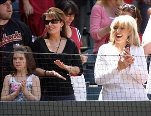 Sarah Palin, left, and Gov. Jan Brewer applaude prior to the start of a baseball game between the Philadelphia Phillies and the Arizona Diamondbacks Sunday, April 25, 2010, in Phoenix.