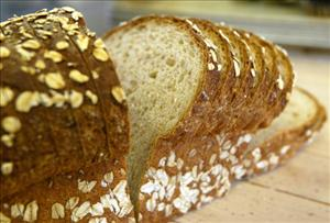 A loaf of sliced wheat bread is seen on the shelf at the Noe Valley Bakery and Bread Co.