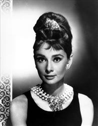 In this image released by Paramount Pictures, Audrey Hepburn is shown in, Breakfast at Tiffany's.