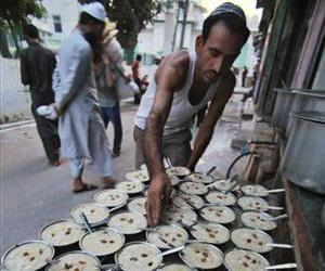 An Indian Muslim man arranges Iftar, the meal that breaks the day long fasting during the holy month of Ramadan in Jammu, India, Wednesday, Aug. 18, 2010.