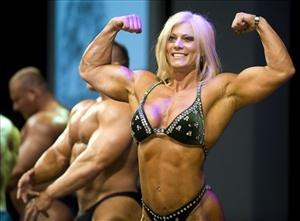 Female bodybuilder Skadi Frei performs at the fitness fair FIBO in Essen, western Germany, this year.