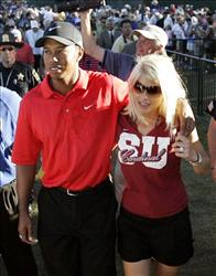 In this Aug. 20, 2006, file photo, Tiger Woods celebrates with wife Elin Nordegren after winning the 88th PGA Championship golf tournament.