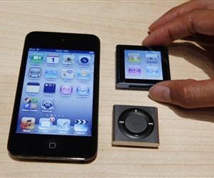 An Apple employee holds a new Apple iPod Nano beside the new Ipod Shuffle and iPod Touch, Sept. 1, 2010, in San Francisco.