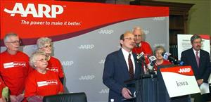 AARP chief executive officer Bill Novelli, standing with AARP volunteers and former Iowa Gov. Terry Branstad, speaks at a news conference, March 28, 2007, at the state Capitol in Des Moines, Iowa.