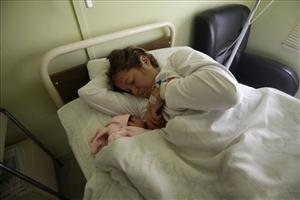 Elizabeth Segovia feeds her daughter, newborn Esperanza Ticona, at the Copiapo Clinic, Copiapo.
