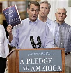 House Minority Leader John Boehner of Ohio, left, holds up a copy of the GOP agenda, A Pledge to America, Thursday, Sept. 23, 2010, at a lumber yard thirty miles from the Capitol.