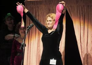 Dr. Elena Bodnar, winner of the Ig Nobel Public Health Prize, displays a bra she designed that converts into a pair of gas masks.