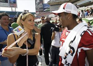 This Jan. 27, 2009,  file photo shows TV Azteca reporter Ines Sainz, left,  after measuring the bicep of Arizona Cardinals wide receiver Steve Breaston, right, in Tampa, Fla.