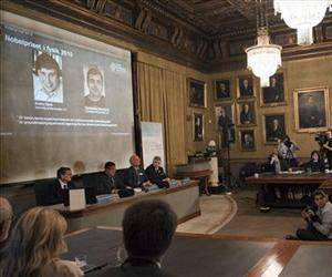 Members of the Swedish Royal Academy of Sciences announce that Russian-born scientists Andre Geim, left on screen, and Konstantin Novoselov share the Nobel Prize in physics, Tuesday.