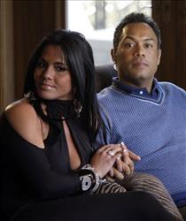 In this Jan. 6, 2010, file photo, retired baseball star Roberto Alomar sits with his wife, Maria Del Pilar Alomar, at his home in the Queens borough of New York.