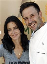 In this Aug. 31, 2009 file photo, David Arquette and Courteney Cox Arquette pose at the launch of The Cheesecake Factory's Drive Out Hunger Tour benefiting Feeding America in Culver City, Calif.
