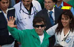 Rescued miner Johnny Barrios waves at the press as he arrives to the hospital for a medical review in Copiapo, Chile, Wednesday Oct. 13, 2010.